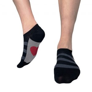 Black sneaker socks with a red heart on the insole